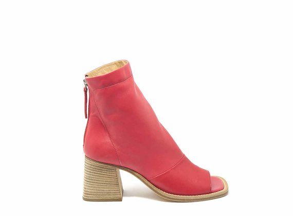Raised red ankle boots