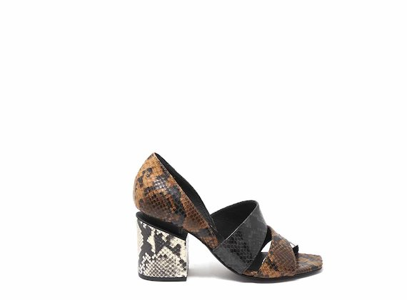 Snakeskin-effect sandals with suspended heels