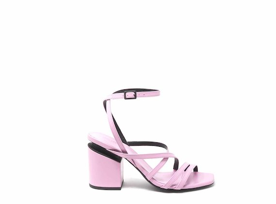Pink sandals with criss-crossing strips and suspended heels