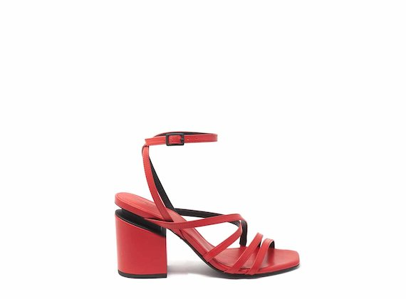 Red sandals with criss-crossing strips and suspended heels