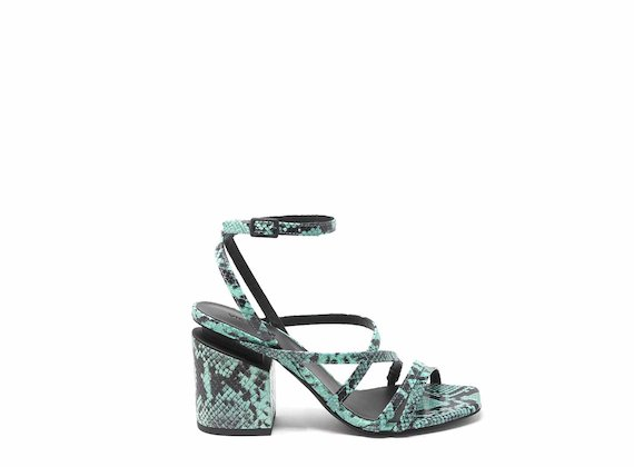 Snakeskin-effect sandals with criss-crossing strips and suspended heels