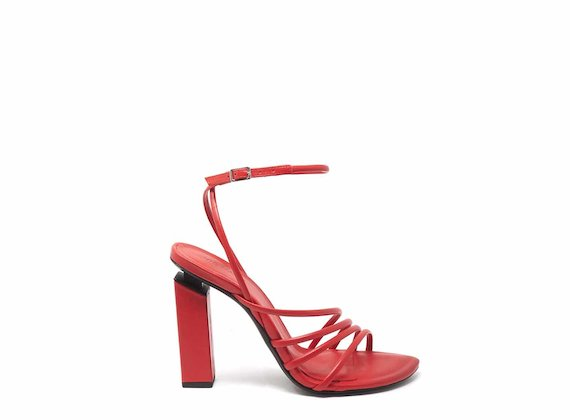 Red high-heeled sandals with strips and ankle strap