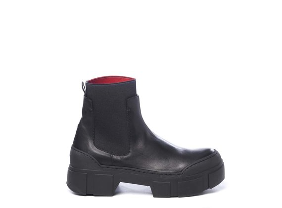 Black calfskin Beatle boots with red elastic inside