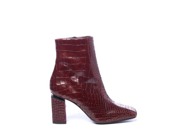 Ruby-red crocodile-print leather ankle boots with suspended heels