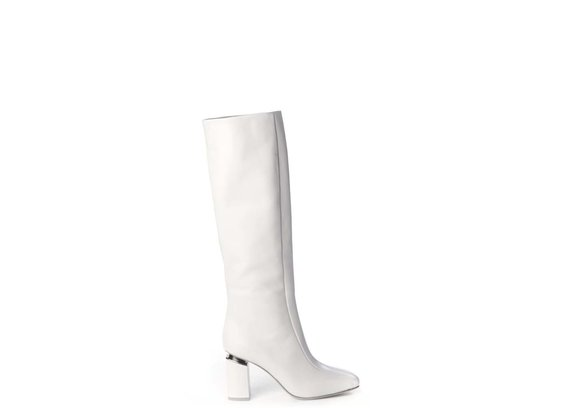 Ice-white high calfskin boots with suspended heels