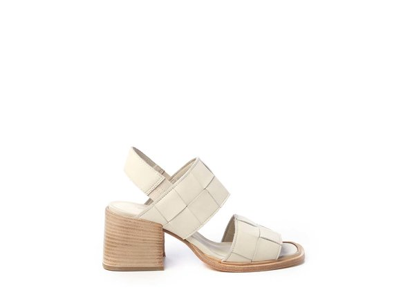 Sandals with criss-crossing bone-white bands