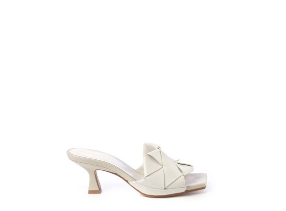 Ivory-coloured slip-ons with spool heel