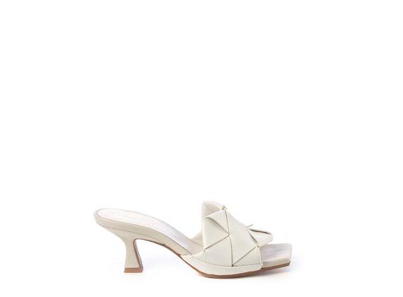Ivory-coloured slip-ons with spool heel