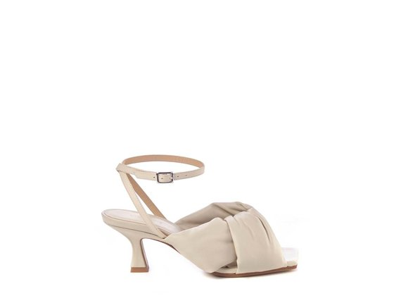 Bone-white sandals with spool heel